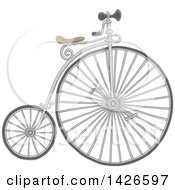 Clipart Of A Cartoon Penny Farthing Bicycle Royalty Free Vector Illustration