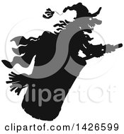 Clipart Of A Black And White Silhouetted Halloween Witch Flying Royalty Free Vector Illustration by Alex Bannykh