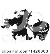 Clipart Of A Black And White Silhouetted Halloween Witch Pushing A Jackolantern In A Wagon Royalty Free Vector Illustration by Alex Bannykh