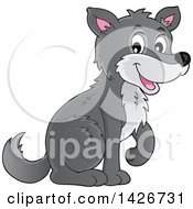 Clipart Of A Cartoon Gray Wolf Sitting Royalty Free Vector Illustration