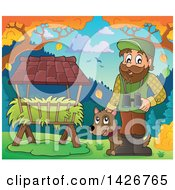 Happy Male Forester By A Hay Trough With Binoculars And A Dog In A Fall Landscape
