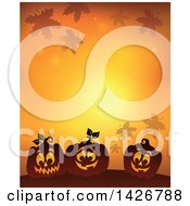 Halloween Background Of Falling Leaves And Silhouetted Jackolantern Pumpkins On Orange