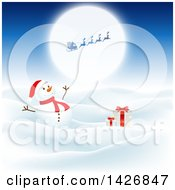Happy Snowman With Gifts In The Snow Under A Silhouetted Santa Against A Full Moon