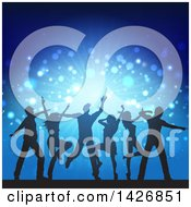 Group Of Silhouetted People Dancing Over Blue Lights