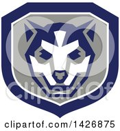 Clipart Of A Retro Wolf Cub Head In A Gray White And Blue Shield Royalty Free Vector Illustration
