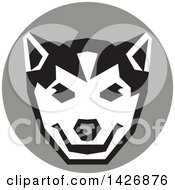 Clipart Of A Retro Wolf Cub Head In A Gray Circle Royalty Free Vector Illustration
