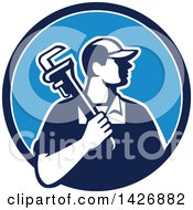 Retro Male Plumber Holding A Monkey Wrench Over His Shoulder In A Blue And White Circle