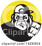 Clipart Of A Retro Black And White Tough Gorilla Wearing A Baseball Cap In A Yellow Circle Royalty Free Vector Illustration
