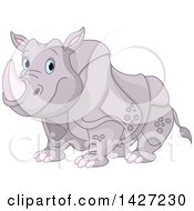 Clipart Of A Cute Adorable Rhinoceros With Blue Eyes Royalty Free Vector Illustration