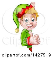 Clipart Of A Happy Caucasian Male Christmas Elf Giving A Thumb Up Around A Sign Royalty Free Vector Illustration