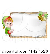 Happy Caucasian Male Christmas Elf Pointing Aorund A Blank Sign With Bells