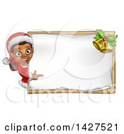 Happy Black Female Christmas Elf Pointing Around A Blank Sign