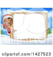 Clipart Of A Happy Black Female Christmas Elf Pointing Around A Blank Sign In A Winter Landscape Royalty Free Vector Illustration