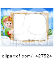 Clipart Of A Happy Caucasian Male Christmas Elf Pointing Aorund A Blank Sign In A Winter Landscape Royalty Free Vector Illustration by AtStockIllustration