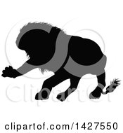 Clipart Of A Black Silhouetted Male Lion Attacking Royalty Free Vector Illustration