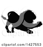 Clipart Of A Black Silhouetted Male Lion Clawing Royalty Free Vector Illustration
