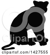 Clipart Of A Black Silhouetted Lioness Sitting Royalty Free Vector Illustration by AtStockIllustration