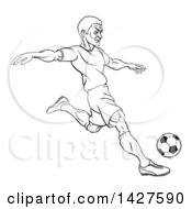 Clipart Of A Black And White Lineart Male Soccer Football Player Kicking A Ball Royalty Free Vector Illustration