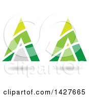 Clipart Of Triangular Pyramidical Green Arrow Letter A Logos Or Icon Designs With Stripes And Shadows Royalty Free Vector Illustration