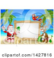 Clipart Of A Happy Rudolph Red Nosed Reindeer And Santa Making Sand Castles On A Tropical Beach By A Blank Sign With A Parrot Royalty Free Vector Illustration