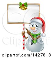 Clipart Of A Happy Christmas Snowman Wearing A Santa Hat And Pointing To A Blank Sign Royalty Free Vector Illustration by AtStockIllustration