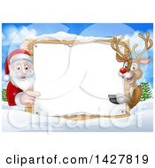 Christmas Santa Claus And Rudolph Red Nosed Reindeer Pointing Around A Sign Over A Winter Landscape