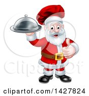 Christmas Santa Claus Chef Giving A Thumb Up And Holding A Cloche Platter