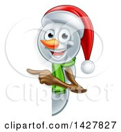 Happy Snowman Wearing A Christmas Santa Hat And Pointing Around A Sign