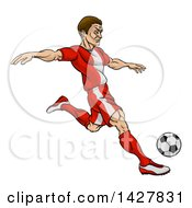 Clipart Of A Cartoon Male Soccer Player In A Red Uniform Kicking A Ball Royalty Free Vector Illustration