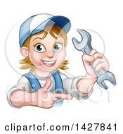 Clipart Of A Cartoon Happy White Female Mechanic Holding Up A Wrench And Pointing Royalty Free Vector Illustration