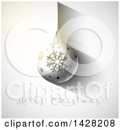 Clipart Of A 3d Suspended Snowflake Bauble Ornament Over Mery Christmas Text On Gray Royalty Free Vector Illustration