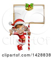 Clipart Of A Happy Black Female Christmas Elf Jumping By A Blank Sign Royalty Free Vector Illustration by AtStockIllustration