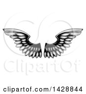 Clipart Of A Pair Of Black And White Etched Wings Royalty Free Vector Illustration