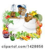 Clipart Of A Happy Black Male Gardener In Blue Holding Up A Garden Shovel And Giving A Thumb Up Over A Blank White Sign With Produce Royalty Free Vector Illustration