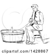 Clipart Of A Vintage Black And White Sketched Man Playing With A Boat In A Bucket Royalty Free Vector Illustration