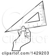 Black And White Hand Holding A Set Square