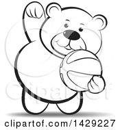 Black And White Bear Playing With A Ball