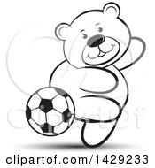 Clipart Of A Black And White Bear Playing Soccer Royalty Free Vector Illustration