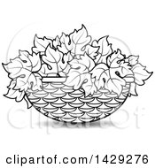 Clipart Of A Black And White Basket Of Grape Leaves Royalty Free Vector Illustration by Lal Perera