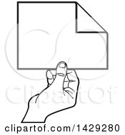 Clipart Of A Black And White Hand Holding A Piece Of Paper Royalty Free Vector Illustration by Lal Perera