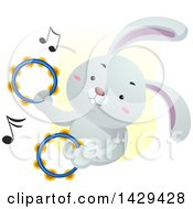 Clipart Of A Cute Bunny Rabbit Playing The Tambourines Royalty Free Vector Illustration