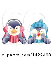 Clipart Of Cute Penguins Wearing A Hat And Ear Muffs Royalty Free Vector Illustration by BNP Design Studio