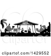 Clipart Of A Black And White Christmas Nativity Scene Of Baby Jesus Mary And Joseph In The Manger With A Donkey And The Magi Wise Men Royalty Free Vector Illustration