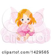 Cute Red Haired Caucasian Toddler Fairy Girl Sitting On A Pink Cloud