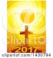 Clipart Of A Silhouetted Cross Against A Sunset With Sparkles Stars And A Swirl With New Year 2017 Royalty Free Vector Illustration by elaineitalia