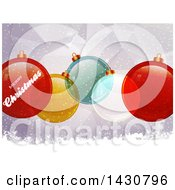 Clipart Of A Merry Christmas Greeting And Colorful Baubles Over A Geometric Background Royalty Free Vector Illustration
