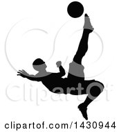 Clipart Of A Black Silhouetted Male Soccer Player Kicking Royalty Free Vector Illustration by AtStockIllustration