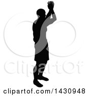 Clipart Of A Black Silhouetted Male Soccer Player Royalty Free Vector Illustration by AtStockIllustration