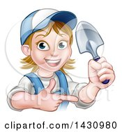 Clipart Of A Cartoon Happy White Female Gardener In Blue Holding A Garden Trowel And Pointing Royalty Free Vector Illustration