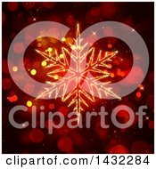 Clipart Of A Sparkly Illuminated Golden Snowflake Over Red Bokeh Flares Royalty Free Illustration